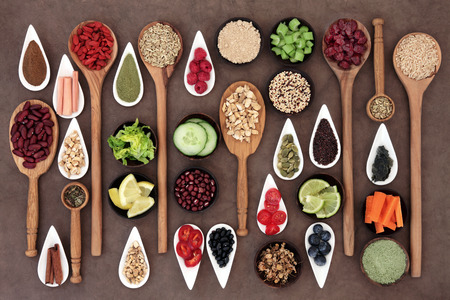 Photo pour Large diet and weight loss superfood selection in bowls and spoons over lokta paper background. - image libre de droit