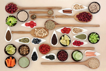 Photo pour Large diet and weight loss superfood selection in bowls and wooden spoons over mottled cream background. - image libre de droit