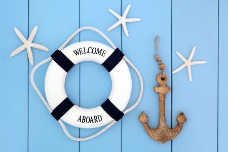 Foto de Decorative lifebuoy, anchor and starfish sea shells over wooden blue background. - Imagen libre de derechos