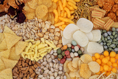 Savory snack food selection forming an abstract background.