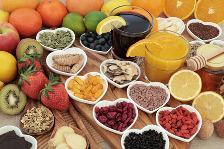 Photo pour Super food selection for cold and flu remedy including foods high in vitamic c and antioxidants with herbal medicine and supplement capsules. - image libre de droit