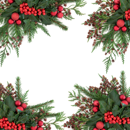 Photo pour Christmas and winter flora with red bauble decorations, holly, ivy, fir and cedar cypress over white background. - image libre de droit