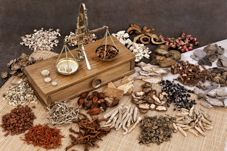 Photo pour Traditional chinese herbal medicine selection with herb ingredients and old scales. - image libre de droit