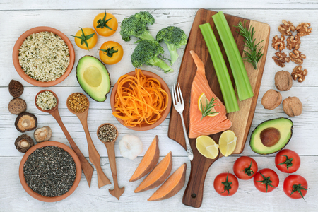 Photo pour Super food to promote brain power concept with fish, vegetables, fruit, seeds, nuts and herbs on rustic wood background. Foods high in omega 3, vitamins, minerals, antioxidants and anthocyanins. Top view. - image libre de droit