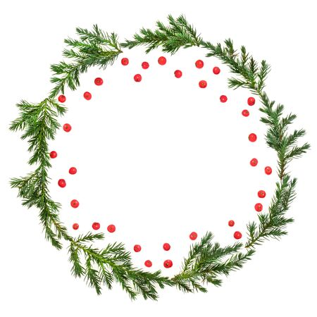 Photo pour Winter and Christmas juniper fir wreath with loose red holly berries on white background with copy space. Traditional symbol for the festive season. Juniperis chinensis. - image libre de droit