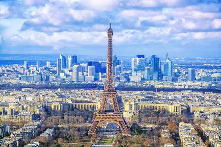 Photo pour Paris cityscape. Aerial view of the main attractions of Paris Eiffel Tower on background of business district of La Defense, seen from Montparnasse skyscraper, France. - image libre de droit