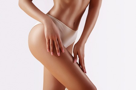 Photo pour Spa and wellness. Healthy slim body in white panties. Beautiful sexy hips with clean skin. Fitness or plastic surgery. Perfect buttocks without cellulite. - image libre de droit