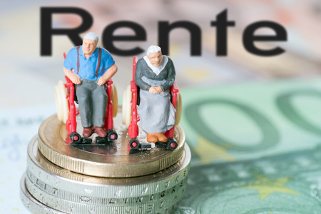 Photo for old man in a wheelchair with money and the german word pension - Royalty Free Image