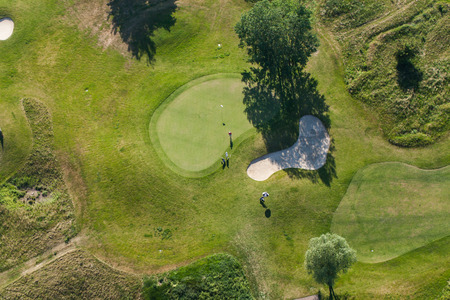 Aerial view over golf field  near Wroclaw city in Poland mural