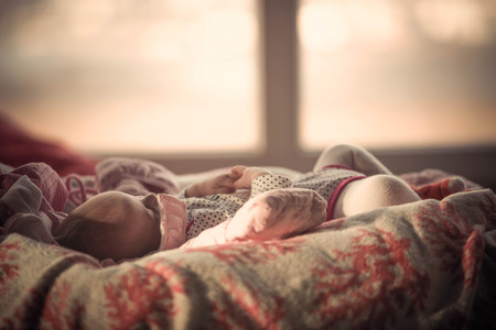 Portrait of sleeping cute baby in home and window is behind