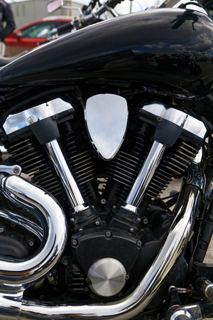 Photo pour Closeup photo of V-type 2-cylinder vee twin engine and exhaust pipes of the motorcycle - image libre de droit