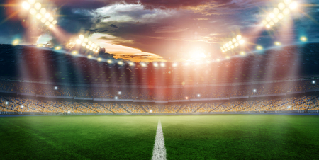 Photo for Stadium in the lights and flashes, football field. Concept sports background, football, night stadium. Mixed media, copy space. - Royalty Free Image