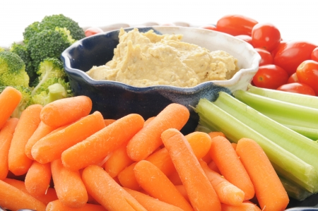 Photo for Closeup of a vegetable platter with Greek style hummus - Royalty Free Image