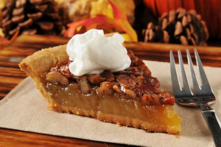 Photo for A slice of pecan pie on a holiday setting - Royalty Free Image