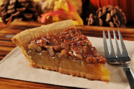 Photo for A slice of pecan pie with a festive autumn, Thanksgiving background - Royalty Free Image