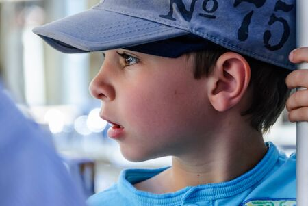 Photo for Close-up of little boy in profile with blue cap - Royalty Free Image