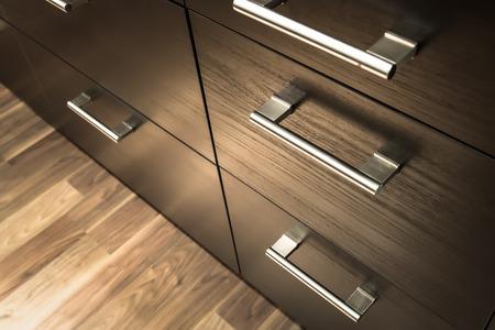 Photo pour a wooden wardrobe drawer front, metal handle - image libre de droit