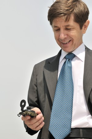 Senior people series - portrait of mature business man looking at compass with copy space
