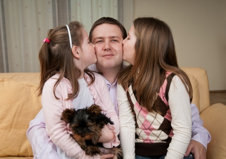 Love - children kissing father
