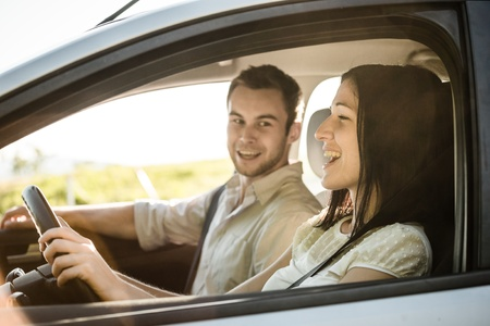 Foto per Happy time together - couple in car singing song - Immagine Royalty Free