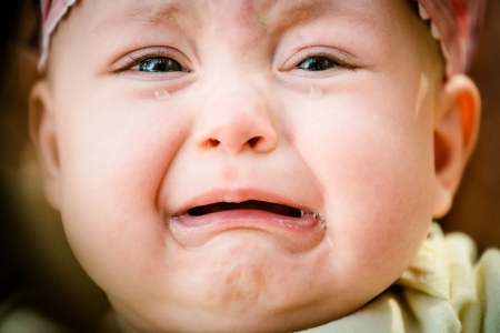 Foto de Baby crying - pure authentic emotion, tears visible - Imagen libre de derechos