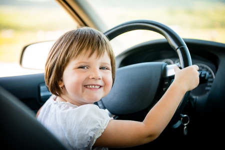 Photo for Child driving car - Royalty Free Image