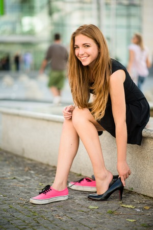 Photo pour Teenager changing shoes - image libre de droit