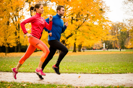 Photo for Couple jogging in autumn nature - Royalty Free Image