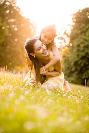Photo pour Mother and child in nature - image libre de droit