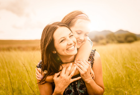 Photo pour Mother and child hugging - image libre de droit