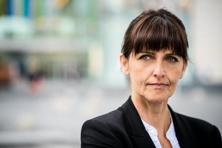 Photo pour Exterior portrait of smiling confident senior business woman looking away - image libre de droit