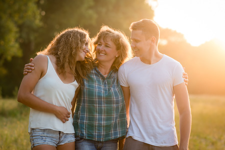 Photo pour Caucasian family outdoors, spending quality time together. - image libre de droit