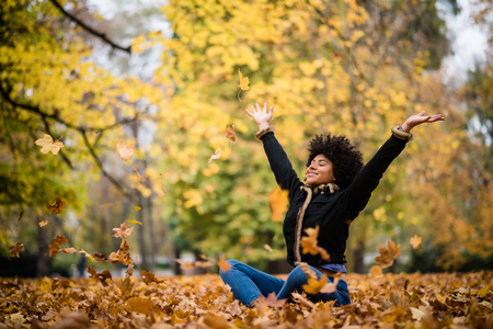 Photo pour Woman united with nature in autumn - image libre de droit