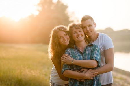 Photo for Mother, daughter and son posing together. Family bonding. - Royalty Free Image