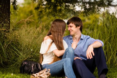 Foto de Cheerful fun loving woman tickling her boyfriend - Imagen libre de derechos