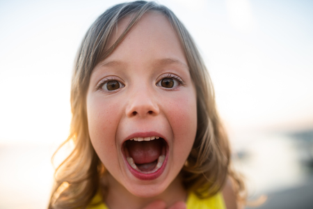 Photo pour Cute kid with mouth wide open, closeup. - image libre de droit