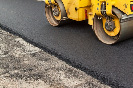 Photo for New asphalt road. Road asphalt works.  Construction works - Royalty Free Image