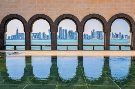 Photo for Doha skyline seen through the arches at the Museum of Islamic art, Doha, Qatar - Royalty Free Image