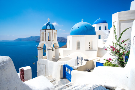 Photo for Scenic view of traditional cycladic white houses and blue domes in Oia village, Santorini island, Greece - Royalty Free Image