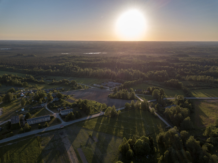 Photo for drone image. aerial view of rural sunset over forest trees with long shadows. latvia - Royalty Free Image
