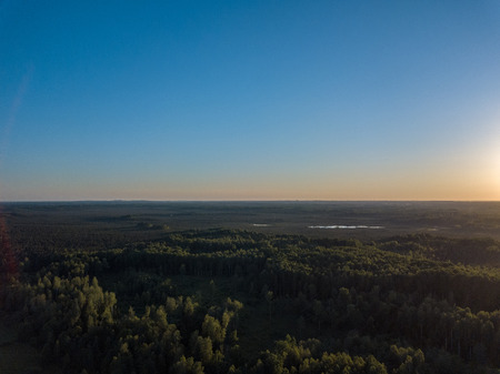 Photo for drone image. aerial view of rural area with fields and forests in cloudy spring day. latvia - Royalty Free Image