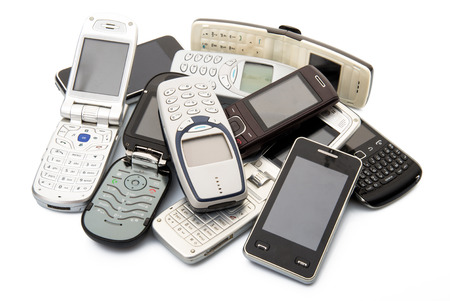 Photo for old and obsolete cellphones on white background - Royalty Free Image