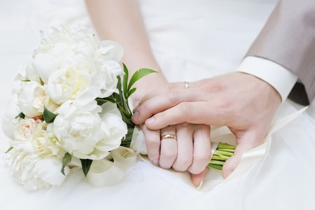 Photo for Bride and groom's hands with wedding rings - Royalty Free Image