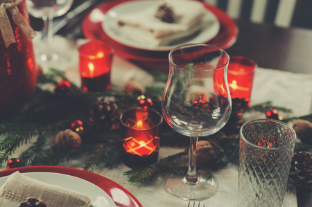 Photo pour Table setting for celebration Christmas and New Year Holidays. Festive traditional red and green table at home with rustic details - image libre de droit
