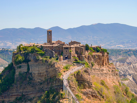 Photo for view of the beautiful Civita di Bagnoregio, Italy, with the famous bridge below and the mountains in the background - Royalty Free Image