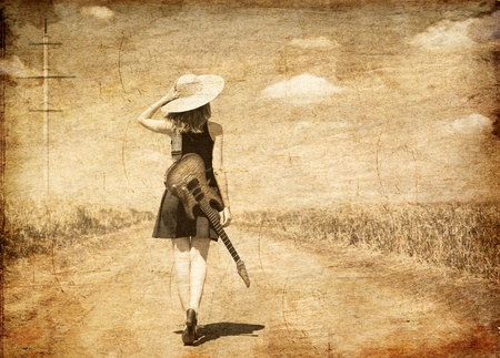 Photo pour Rock girl with guitar at countryside. Photo in old image style. - image libre de droit