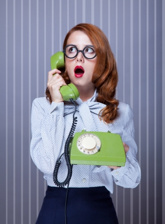 Photo for Women with green telephone - Royalty Free Image