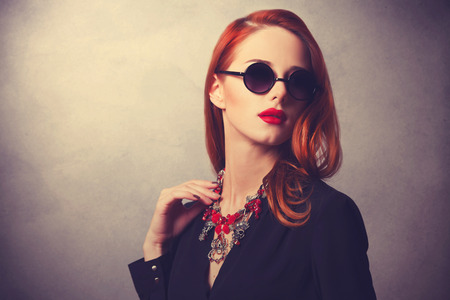 Photo pour Portrait of a style redhead women - image libre de droit