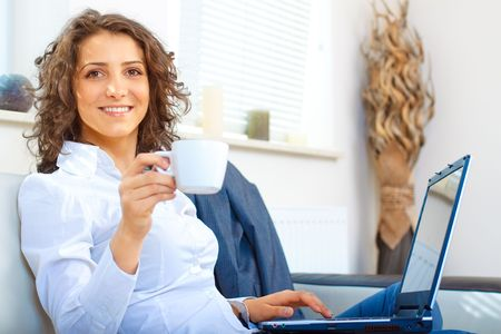 Business woman at home using laptop