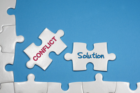 Photo for Conflict and Solution word on white puzzle - Business Concept - Royalty Free Image